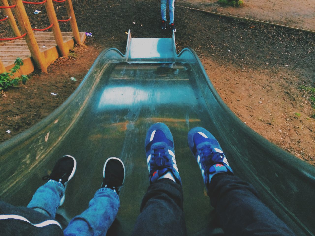 low section, human leg, personal perspective, shoe, human body part, high angle view, real people, standing, one person, leisure activity, outdoors, day, men, water, people