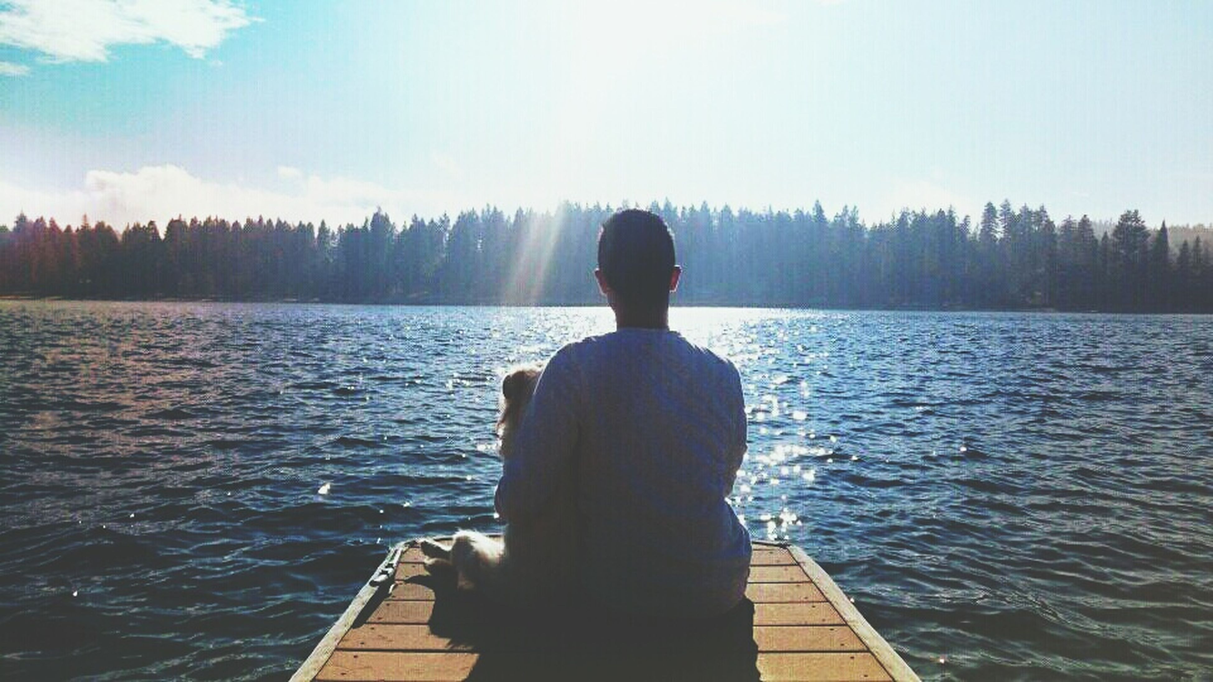water, rear view, lifestyles, standing, leisure activity, lake, tranquility, tranquil scene, scenics, nature, beauty in nature, sky, three quarter length, looking at view, river, men, full length, waist up