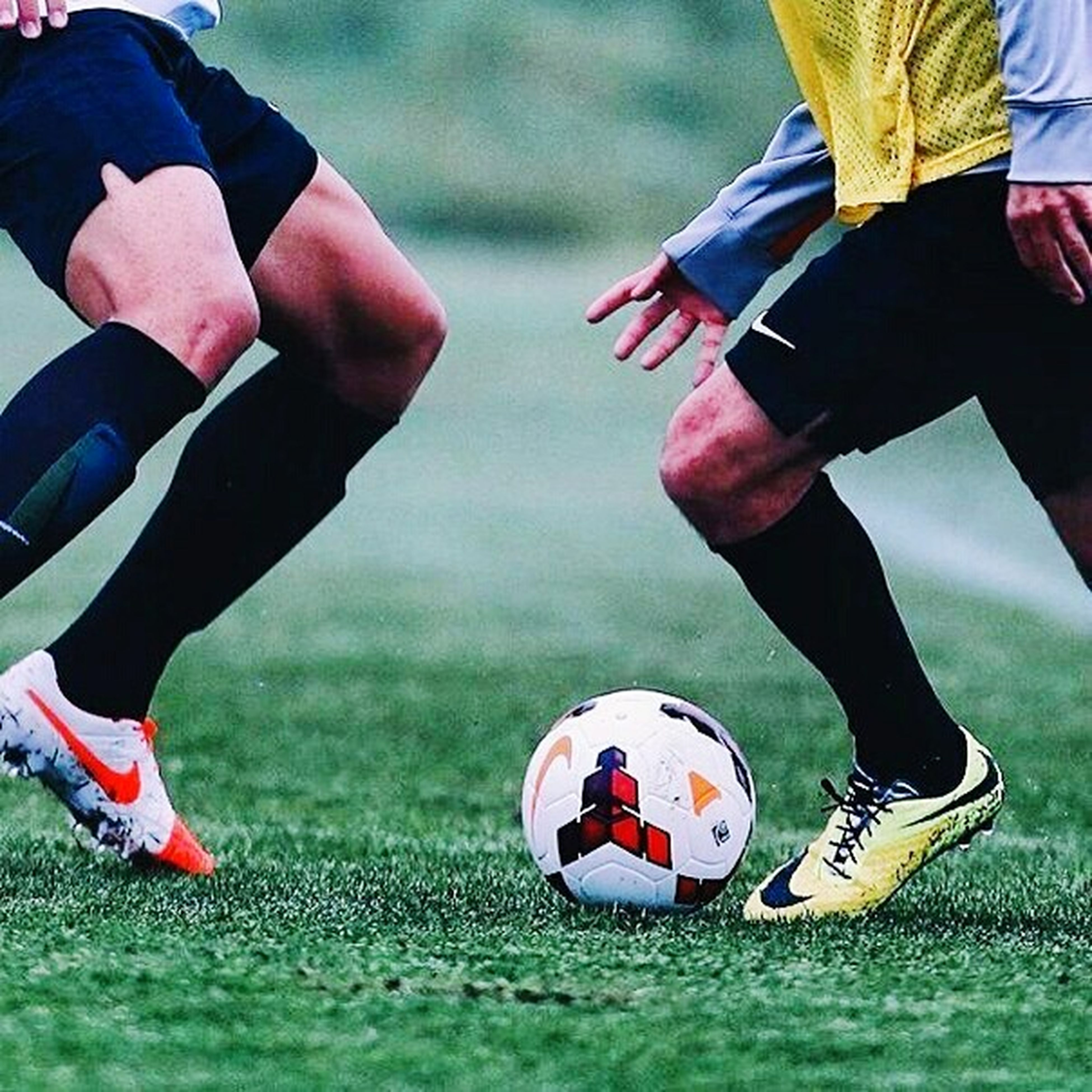 soccer, soccer ball, soccer field, ball, soccer player, sportsman, grass, people, kicking, young adult, only men, adult, low section, outdoors, human body part, adults only, soccer shoe, day