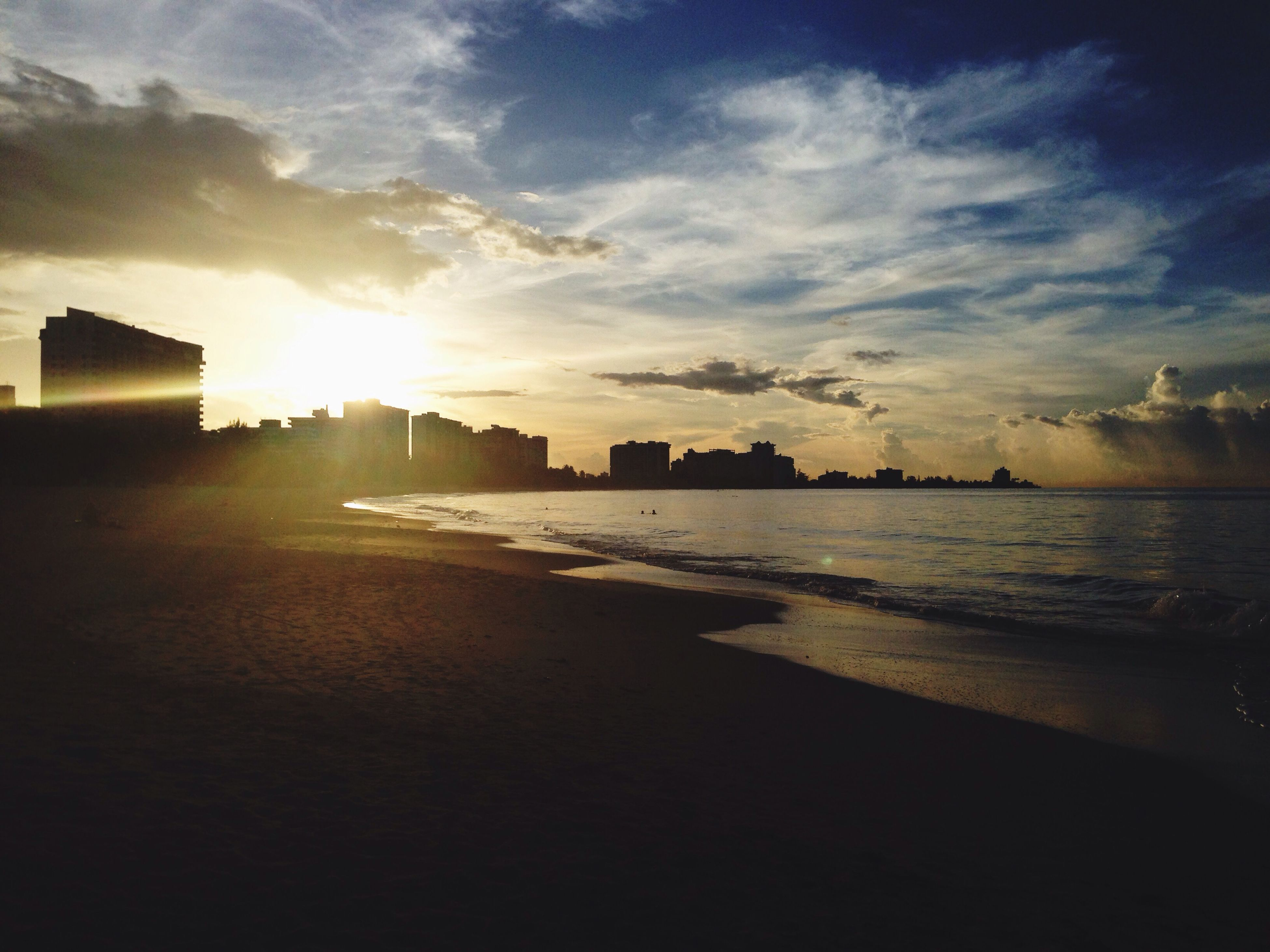 sea, water, sunset, sky, beach, sun, building exterior, built structure, architecture, shore, sunlight, cloud - sky, scenics, sand, beauty in nature, tranquil scene, tranquility, nature, sunbeam, horizon over water