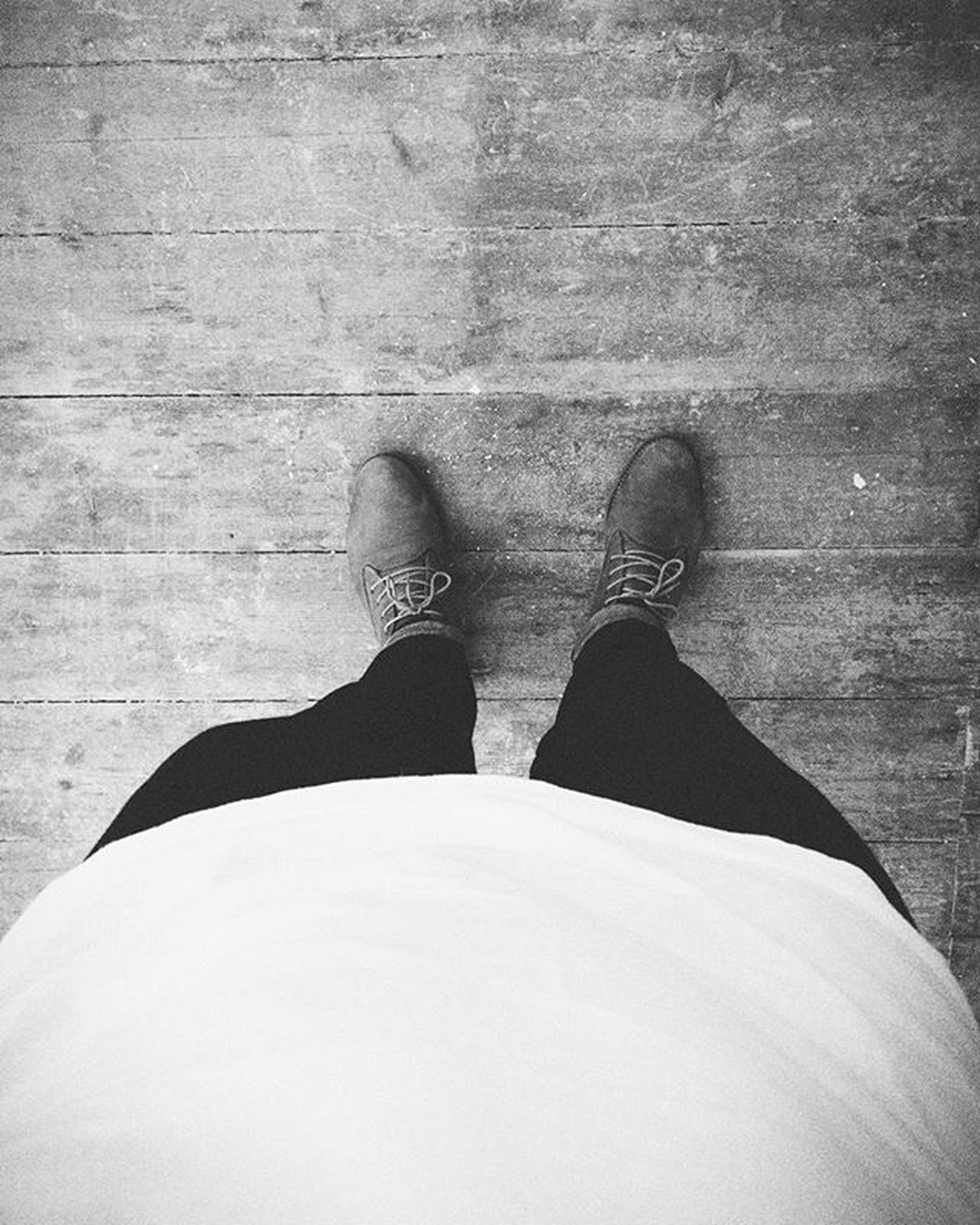 low section, person, shoe, standing, personal perspective, lifestyles, human foot, footwear, high angle view, leisure activity, jeans, men, casual clothing, flooring, relaxation, day