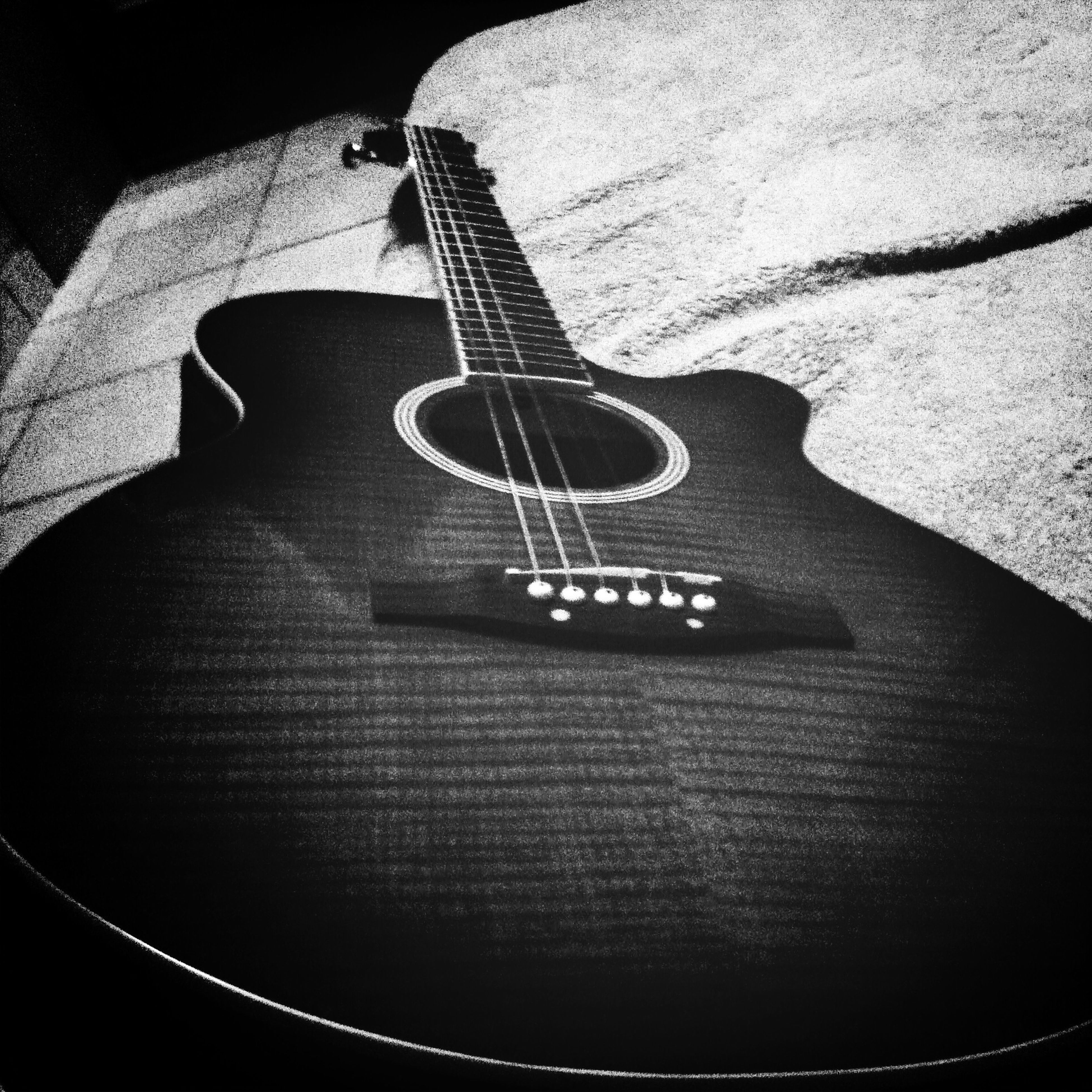 music, musical instrument, indoors, guitar, musical instrument string, musical equipment, arts culture and entertainment, high angle view, close-up, still life, string instrument, acoustic guitar, technology, single object, selective focus, metal, table, no people, part of, hobbies