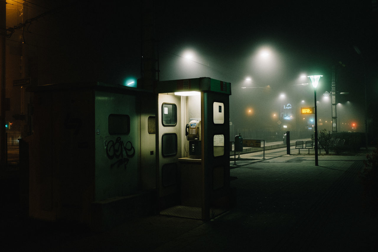 🔇 night telephone telephone booth illuminated no people pay phone outdoors Lost in the Landscape EyeEm Best Shots Nightphotography EyeEmBestPics Lowlight shootermag streetphotography fog