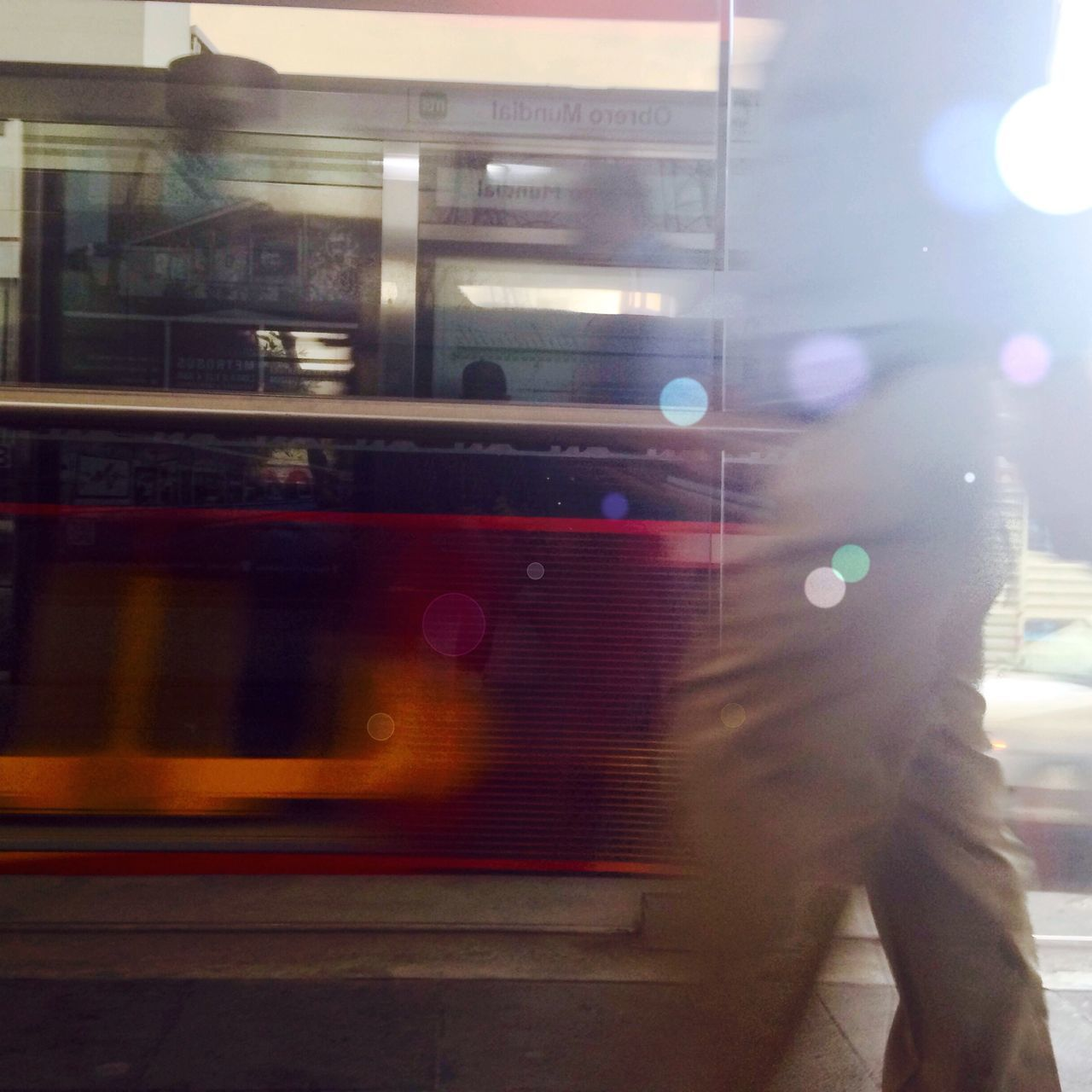 blurred motion, transportation, mode of transport, public transportation, lens flare, speed, motion, train - vehicle, one person, street, real people, land vehicle, men, outdoors, illuminated, day, people