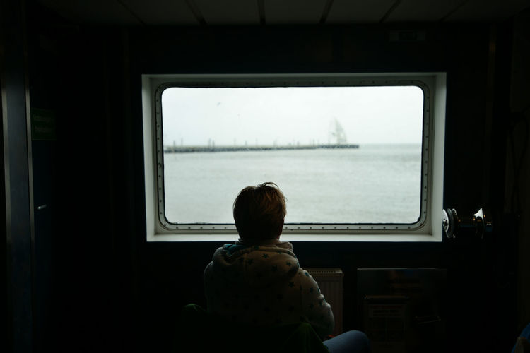 Travelling Age Boys Childhood Georgian Photographer Lashafox Leisure Activity Lifestyles Looking Through Window Norden North Sea Old One Boy Only One Person Real People Rear View Ship Sitting Transportation Travel Destinations Tsertsvadze View From Above Window Second Acts