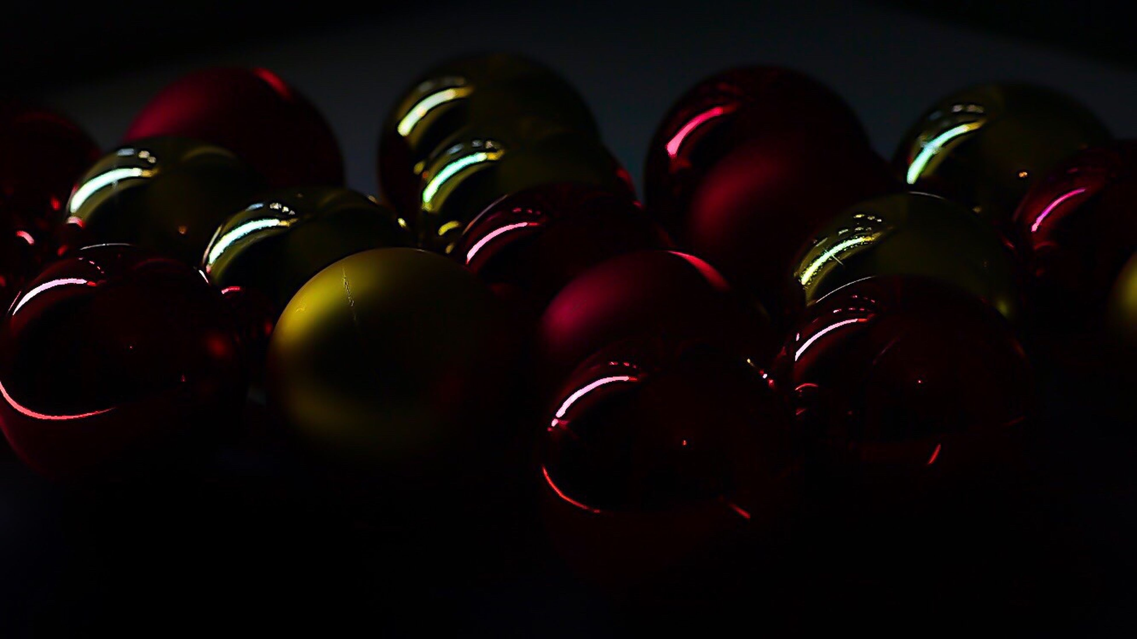 large group of objects, red, dark, food and drink, indoors, no people, close-up, day