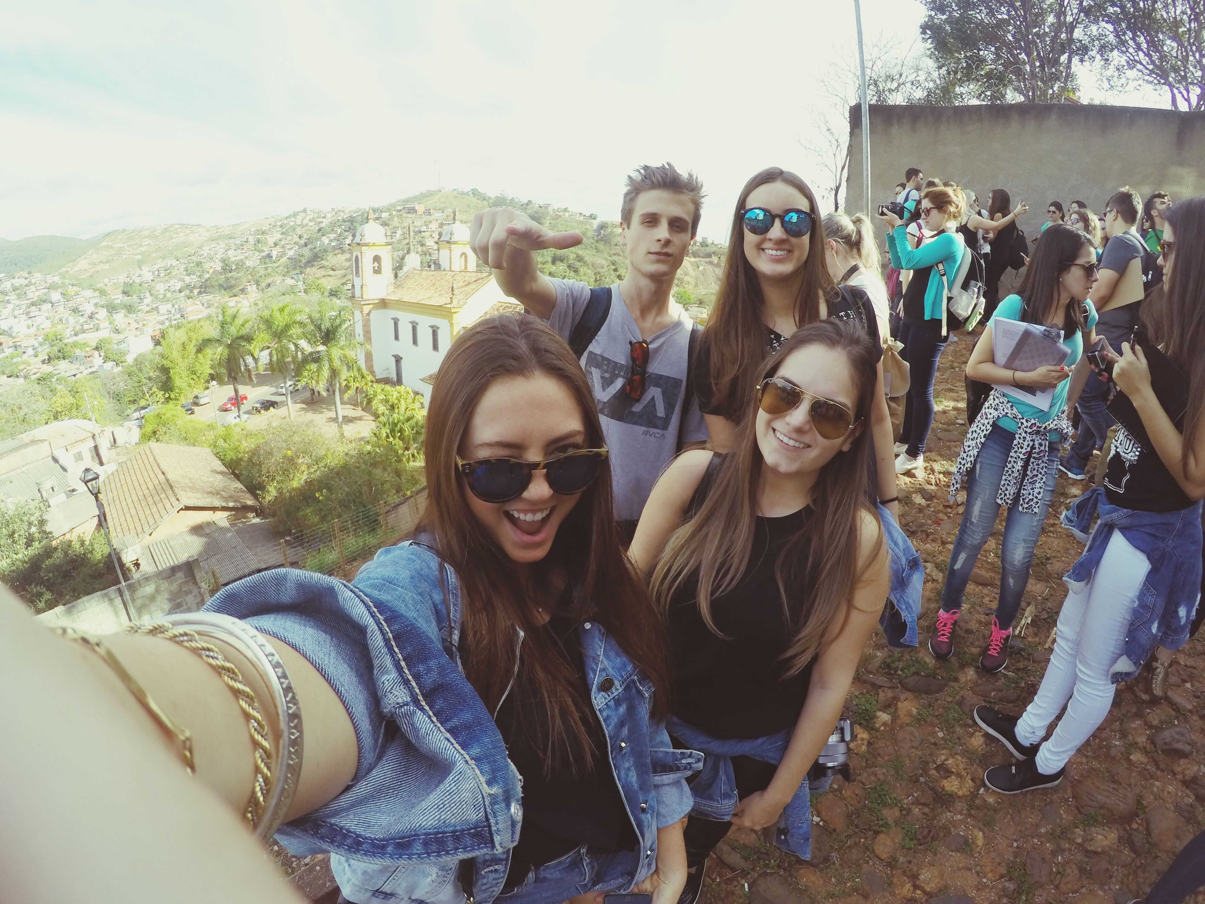 togetherness, young women, portrait, leisure activity, lifestyles, friendship, young adult, looking at camera, bonding, architecture, love, standing, building exterior, smiling, built structure, person, casual clothing, toothy smile, sky, long hair, outdoors, day, friend