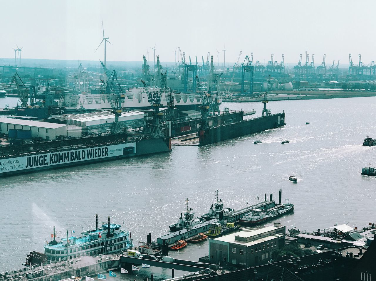 Nautical Vessel Freight Transportation Transportation Mode Of Transport Shipping  Harbor Container Ship Cargo Container High Angle View Ship Commercial Dock Crane - Construction Machinery Industry Water Sea Industrial Ship Moored Day Outdoors Building Exterior