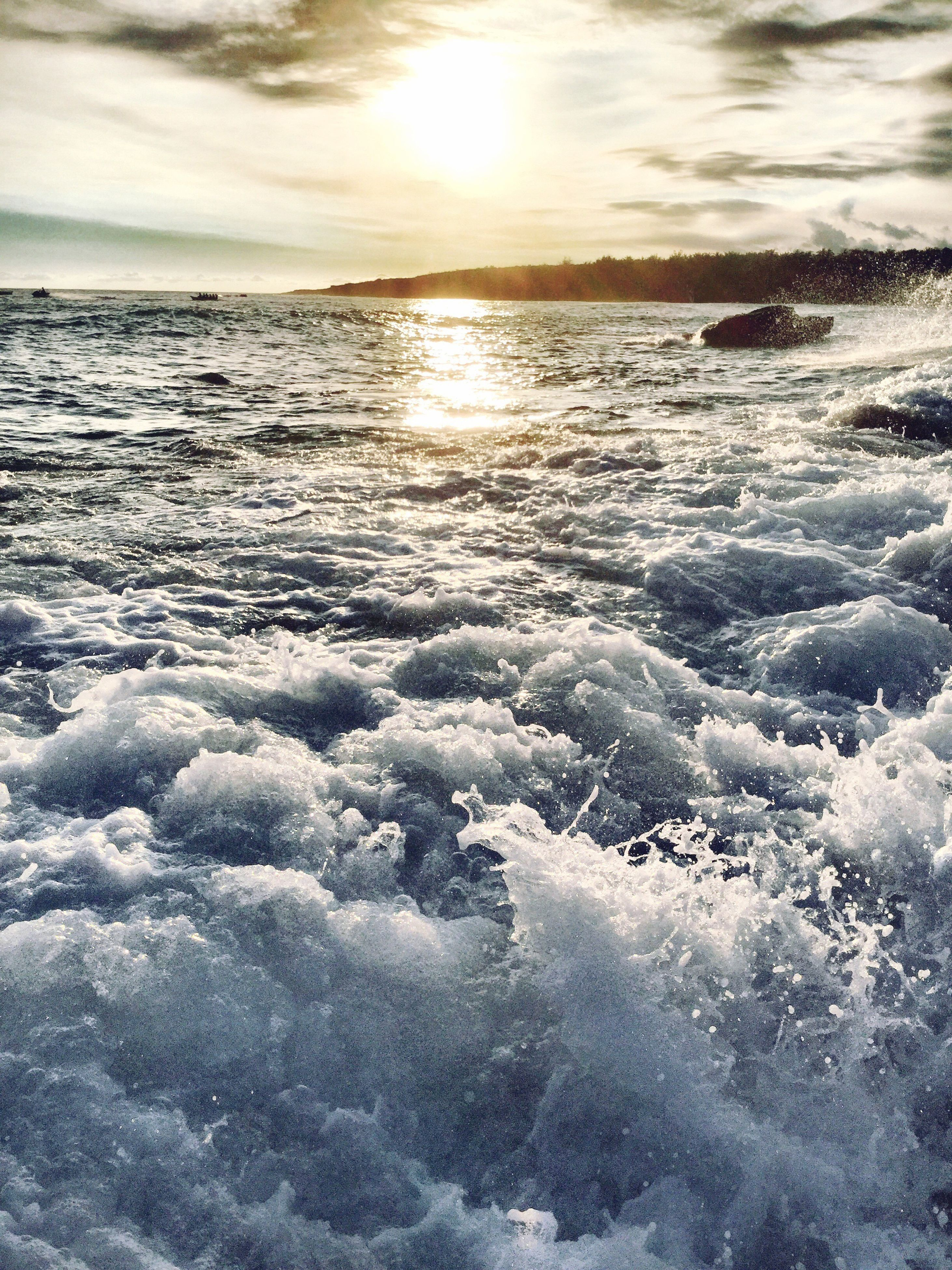 water, sea, scenics, sunset, cold temperature, winter, beauty in nature, tranquil scene, nature, horizon over water, tranquility, snow, surf, frozen, idyllic, sky, sun, shore, cloud, seascape, outdoors, cloud - sky, majestic, ocean, non-urban scene, wave, remote