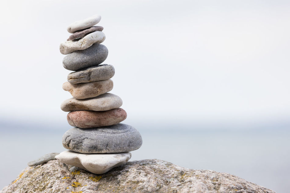 Balanced stack of pebbles on a big rock Balance Baltic Sea Beach Beauty In Nature Close-up Copy Space Day Focus On Foreground Gray Horizon Over Water Nature Outdoors Overcast Pebble Relaxation Rock - Object Sea Seascape Selective Focus Simplicity Sky Stability Stack Water Zen-like