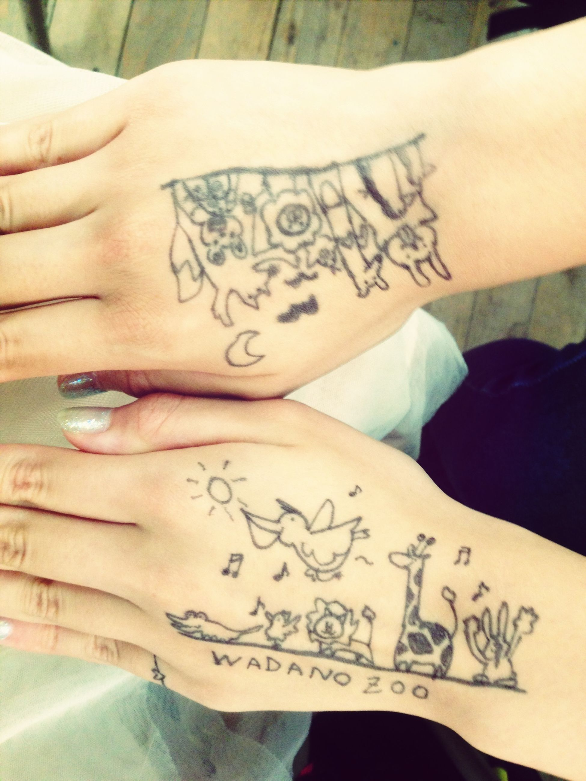 person, indoors, text, western script, communication, lifestyles, part of, creativity, close-up, human finger, art, paper, leisure activity, midsection, cropped, tattoo