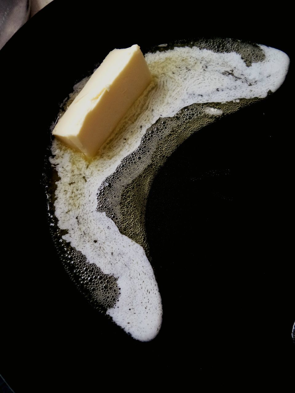 High Angle View Of Butter Melting On Frying Pan