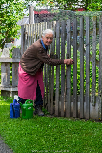 old woman 1 Alpine Casual Clothing Color Portrait Country Life Day Expression Face Grey Hair Life Experience Old Woman Portrait Outdoors Watering Can