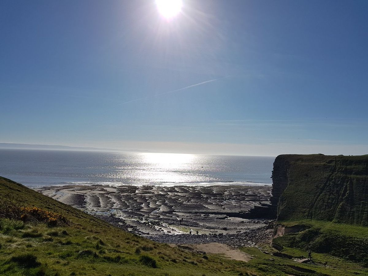 Seascape at Nash Point Sea Beach Sun Horizon Over Water Water Sand Outdoors Sunlight Nature Sky Day Tranquility No People Scenics Beauty In Nature Nash Point Sea And Sky Nofilter Wanderlust Travel Destinations Beauty In Nature Discover Wales Sunshine Walks Visit Wales