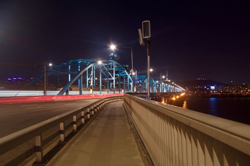 Architecture Bridge - Man Made Structure Building Exterior Built Structure Business Finance And Industry City City Street Cityscape Connection Illuminated Light Trail Long Exposure Motion Neon Night No People Outdoors Road Sky Speed Street Light Transportation Travel Travel Destinations Water