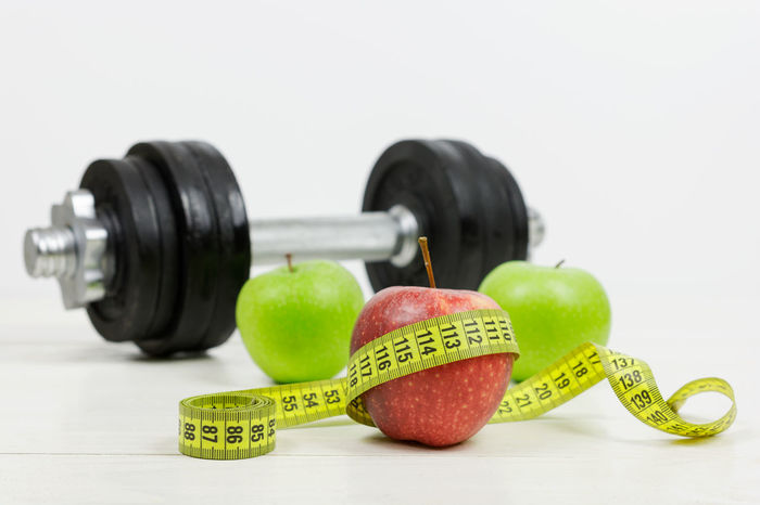 Healthy lifestyle concept Apple Diet Diet & Fitness Centimeter Concept Dumbbell Fitness Food Fruit Healthy Eating Healthy Lifestyle Loosing Weight  No People Nutrition Sport And Nutrition Still Life Studio Shot White Background