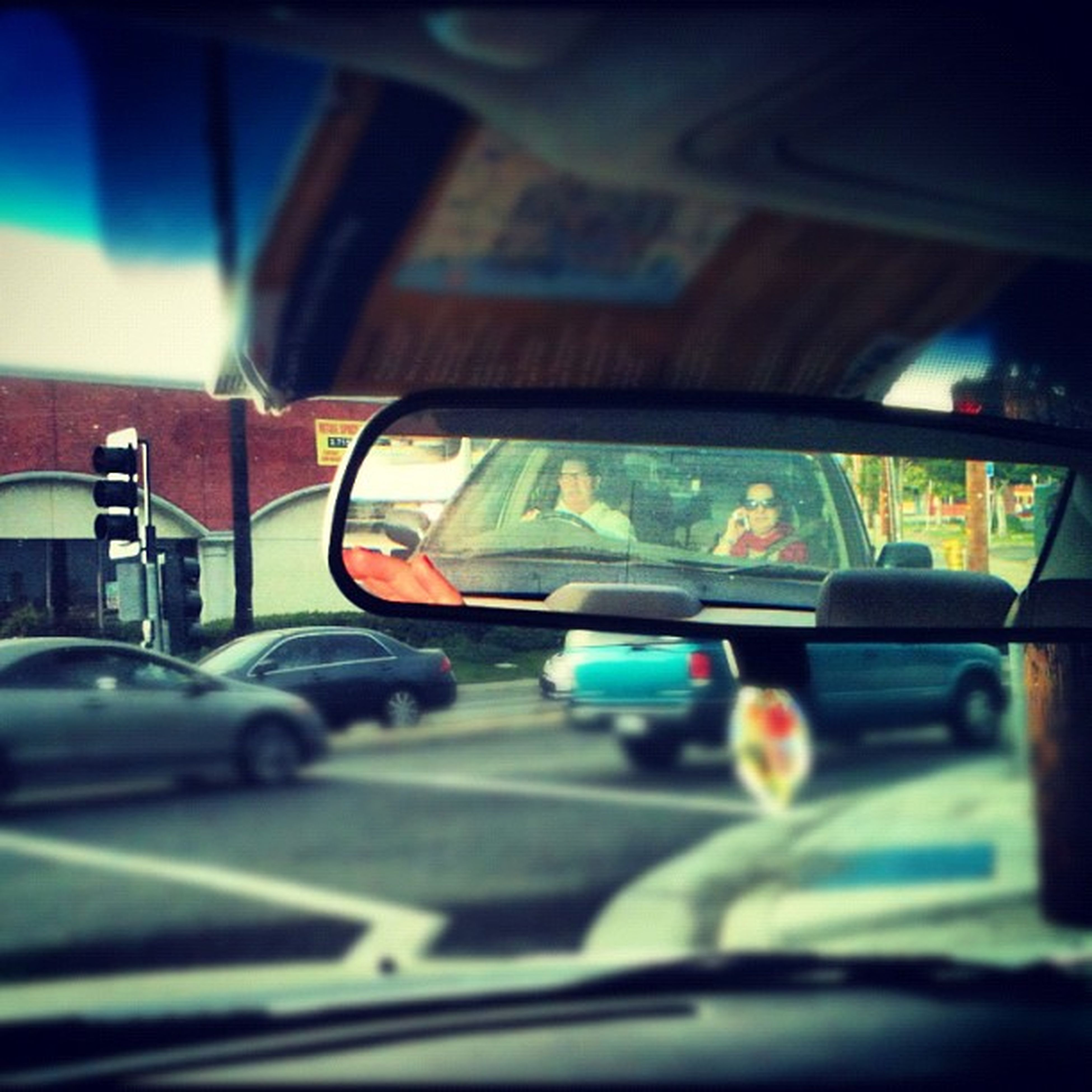 transportation, mode of transport, land vehicle, car, travel, vehicle interior, on the move, public transportation, vehicle seat, selective focus, blurred motion, journey, car interior, road, bus, train - vehicle, windshield, passenger train, street