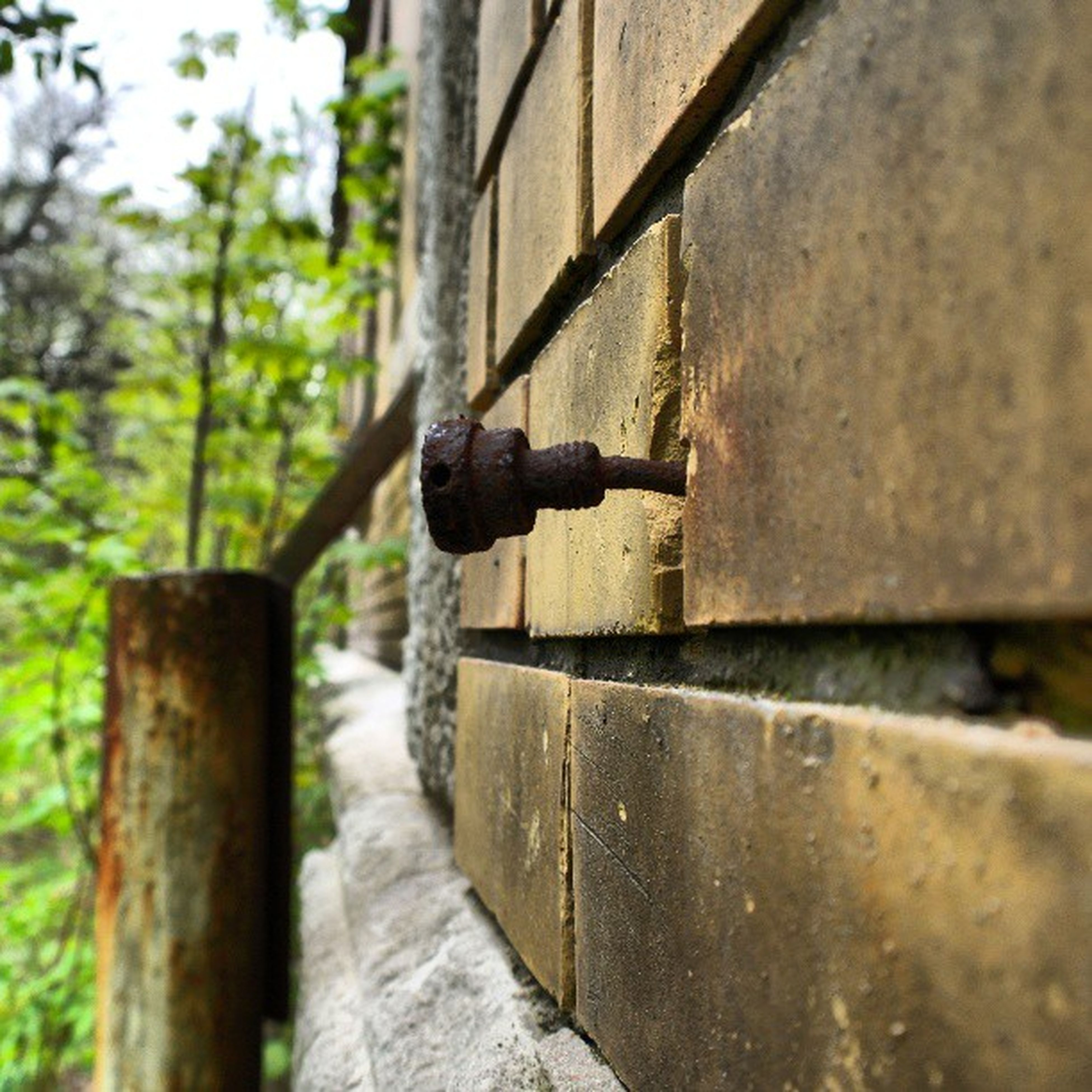metal, focus on foreground, selective focus, railing, close-up, day, built structure, steps, the way forward, wall - building feature, outdoors, old, metallic, protection, wood - material, rusty, architecture, wall, no people, textured