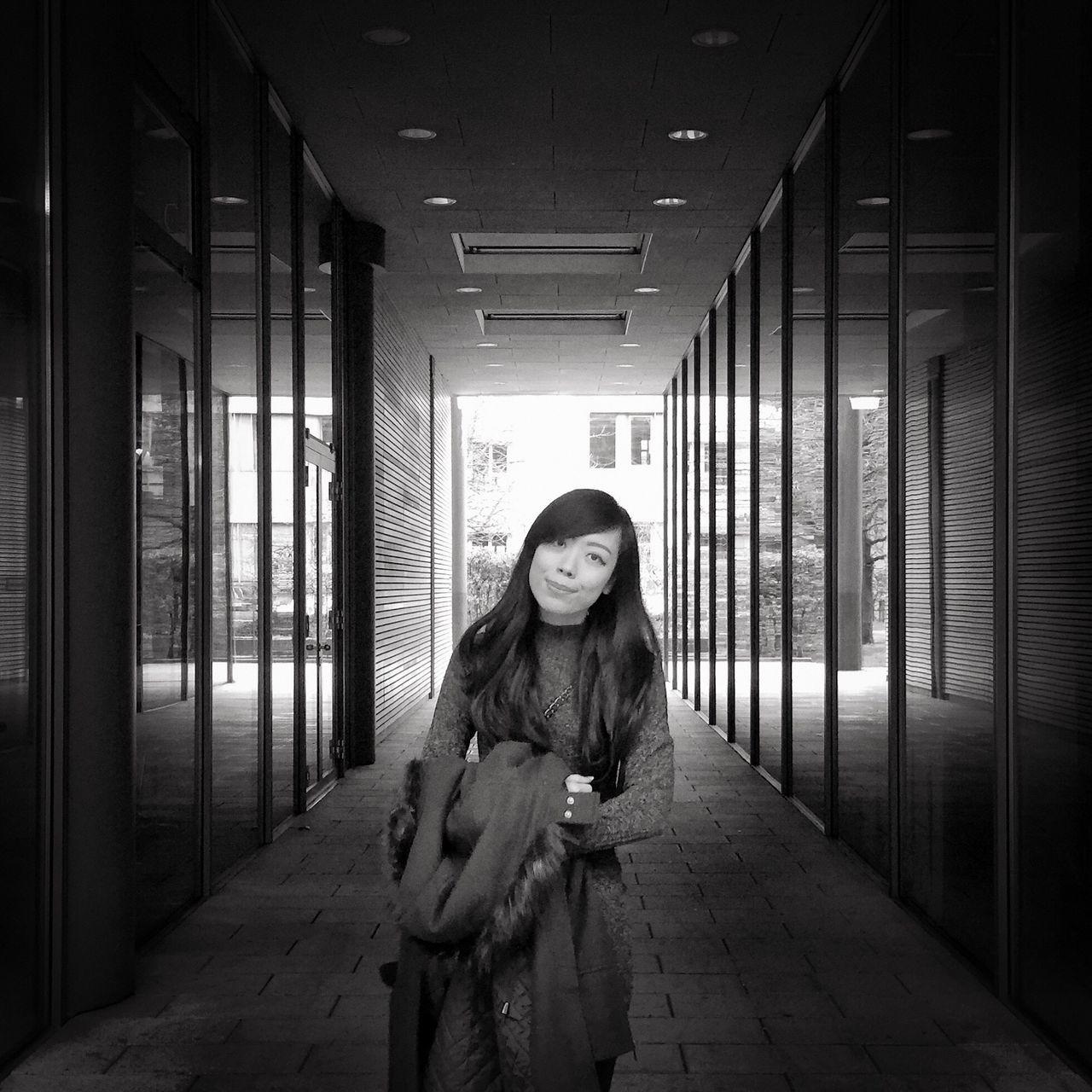 Portrait Of Woman Standing In Corridor
