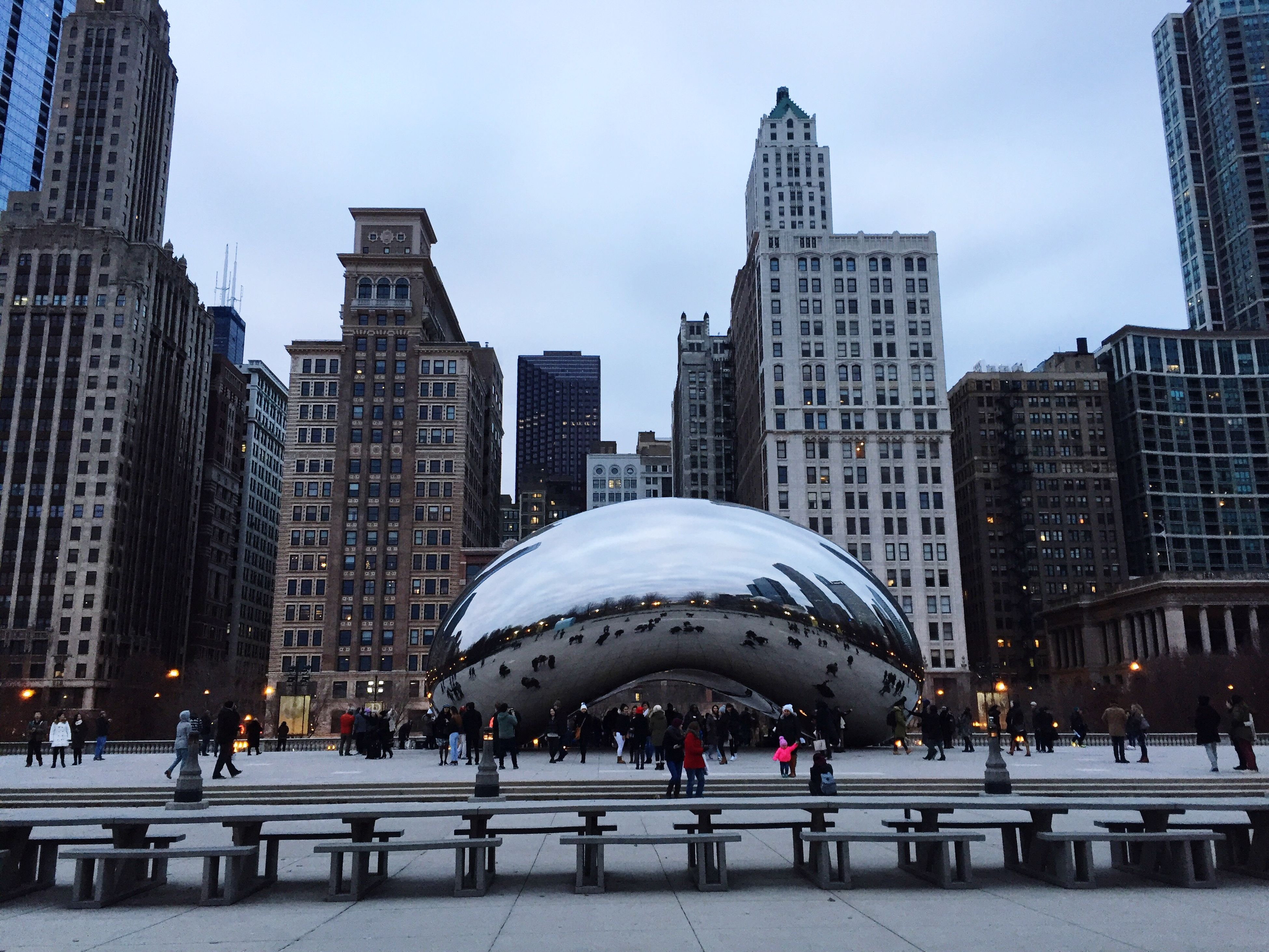 building exterior, architecture, city, built structure, modern, travel destinations, skyscraper, outdoors, sky, urban skyline, large group of people, cityscape, day, people, ice rink