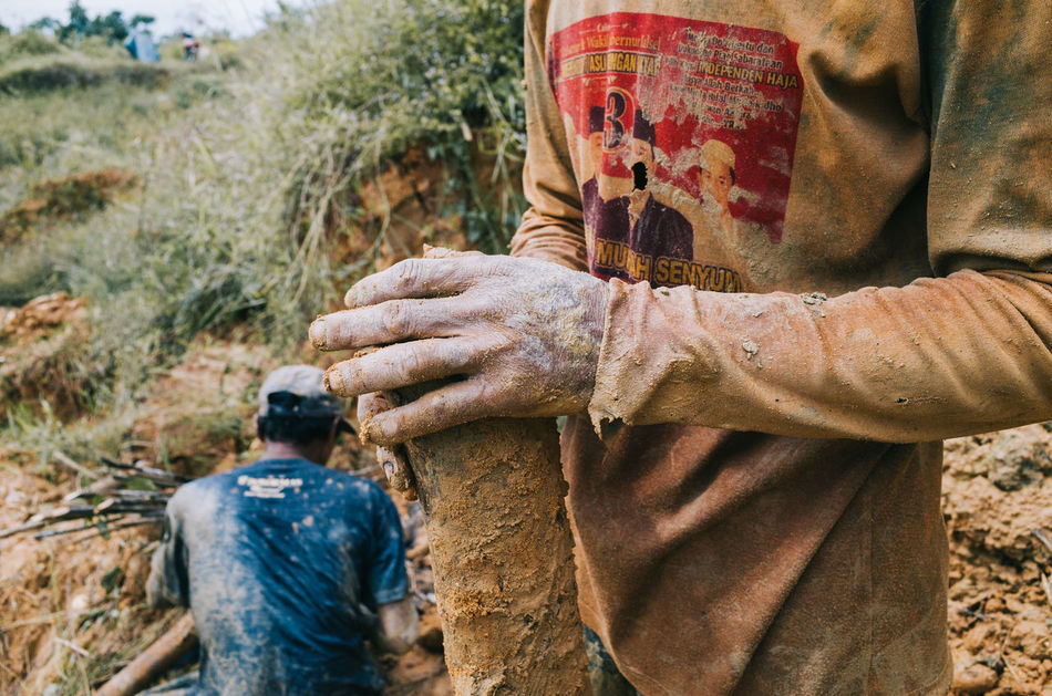 Hands dirty to find shiny. As brilliant coming from the muddy earth. | from my last visit to diamond mine in Cempaka, South Borneo. Adults Only Close-up Human Body Part Human Hand Men Midsection Mine Miner People Real People Togetherness Work