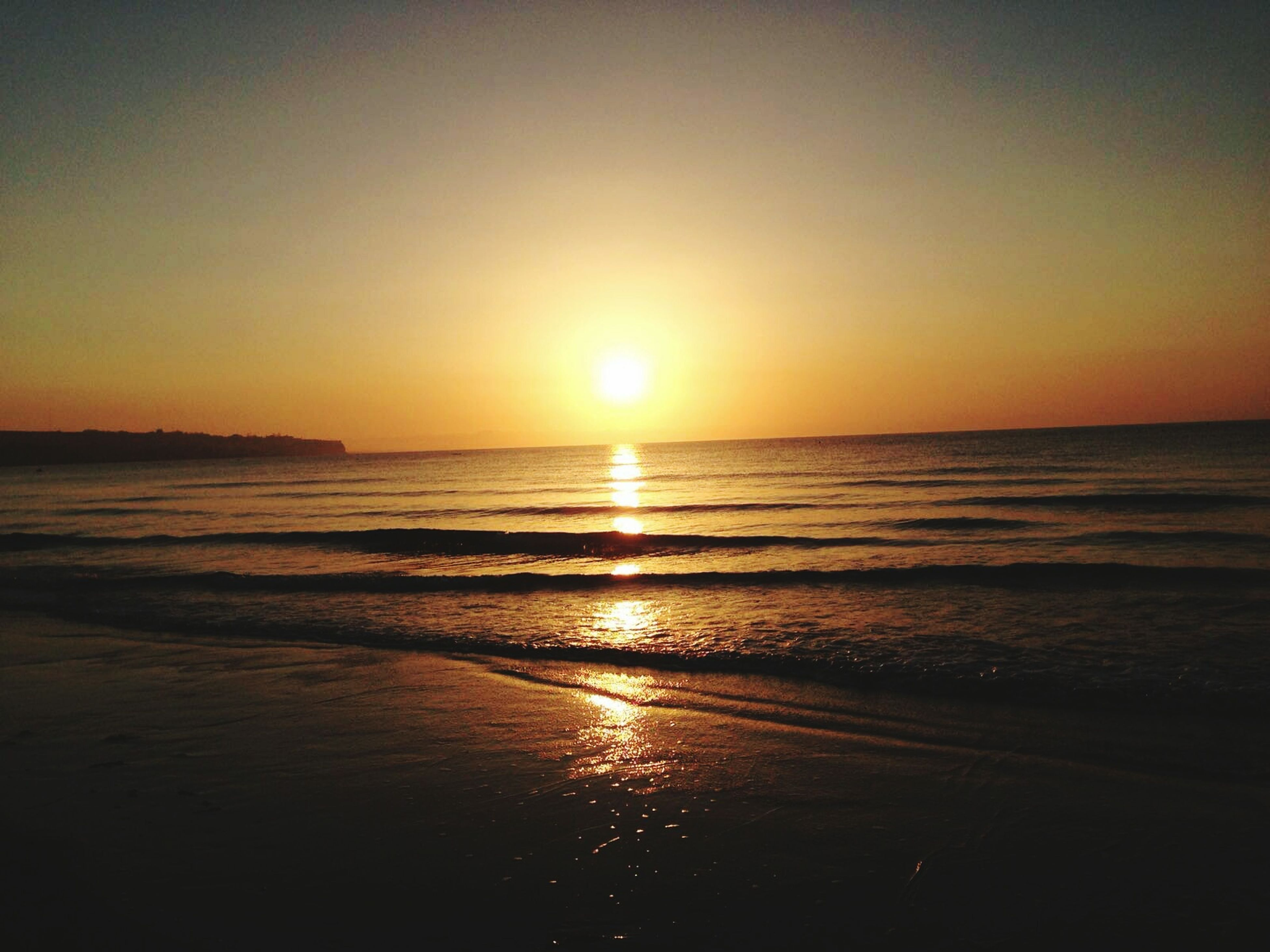 sunset, water, beach, sea, sun, scenics, tranquil scene, shore, beauty in nature, horizon over water, tranquility, reflection, travel destinations, idyllic, majestic, tourism, vacations, wave, nature, seascape, non-urban scene, orange color, back lit, atmosphere, tide, sky, calm, romantic sky, dramatic sky, coastline, outdoors, vibrant color