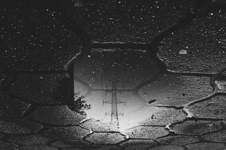 It's getting electric. Reflection on Water Water Reflections Blackandwhite Pole