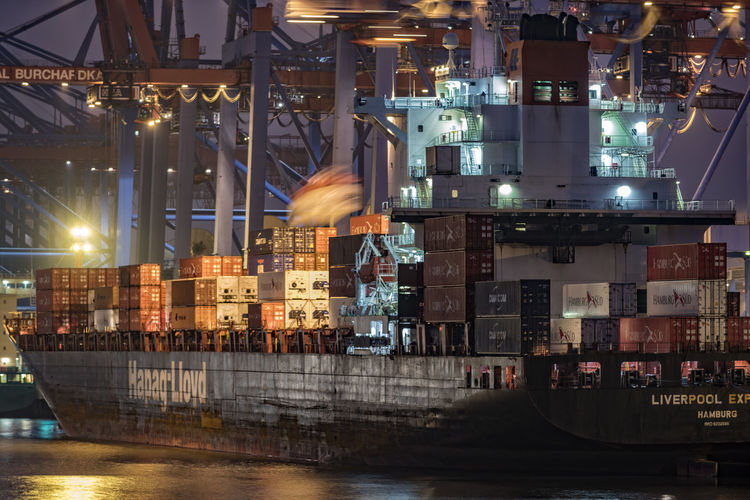ContainerMotion Blurred Motion Business Finance And Industry City Container Container Bridges Container Ship Container Terminal Burchardkai Elbe River Hamburg Harbour Illuminated Industry Liverpool Express Manufacturing Equipment Metal Night Night Photography Night Working No People Outdoors Technology Waltershofer Hafen Water