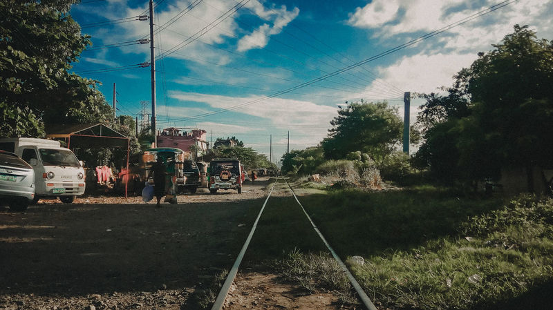 PNR SUCAT, Philippines Outdoors Cloud - Sky Day No People Nature Streets Train Travel Philippines Philippinesphotography Train Tracks Train - Vehicle Road Photograpy Colors Of Nature Urban Life Is Beautiful Lifeofadventure Life's Journey  Light And Shadow Adventure Travelphotography