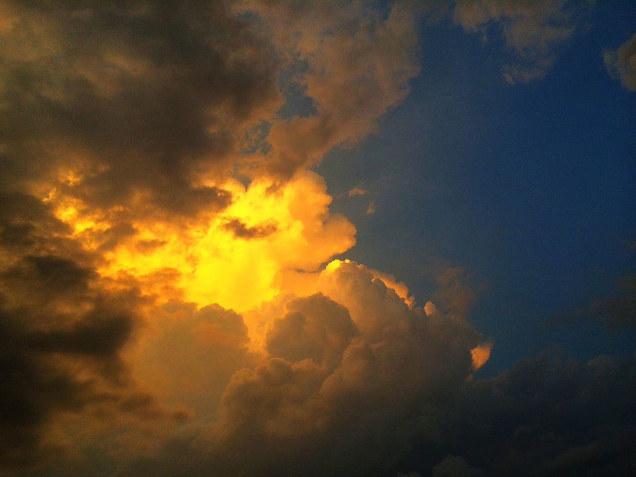 beauty in nature, sky, cloud - sky, nature, scenics, sunset, tranquility, majestic, dramatic sky, tranquil scene, sky only, low angle view, no people, silhouette, outdoors, storm cloud, day