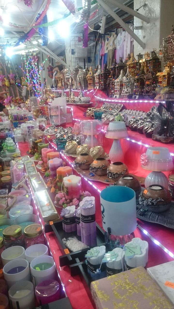 retail, for sale, store, choice, variation, large group of objects, sweet food, indoors, abundance, collection, multi colored, food and drink, market, food, no people, night, consumerism, temptation, unhealthy eating, illuminated, freshness, close-up