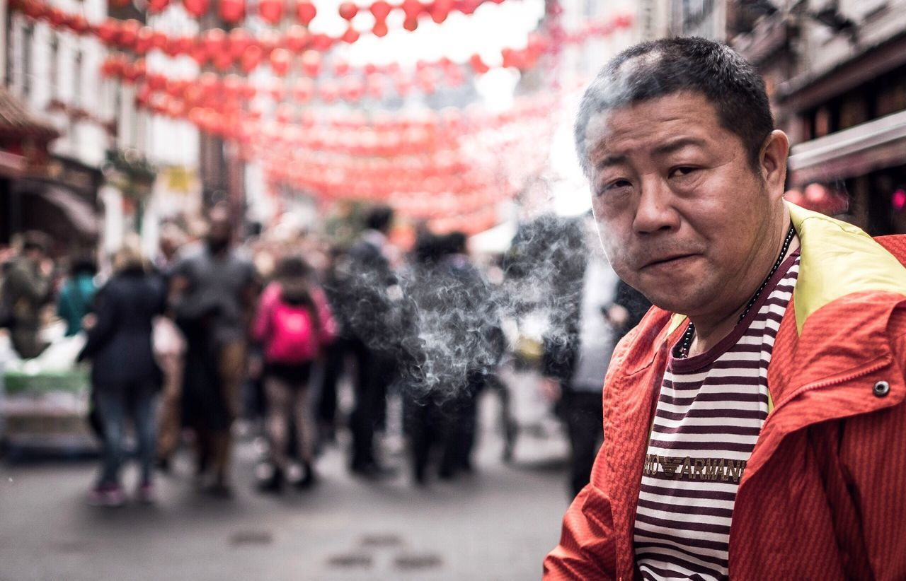 The Street Photographer - 2017 EyeEm Awards smoke break Real People Incidental People Focus On Foreground Outdoors Men Lifestyles One Person Day City Portrait Streetphotography Street Photography Smoking Looking At Camera People London Chinatown