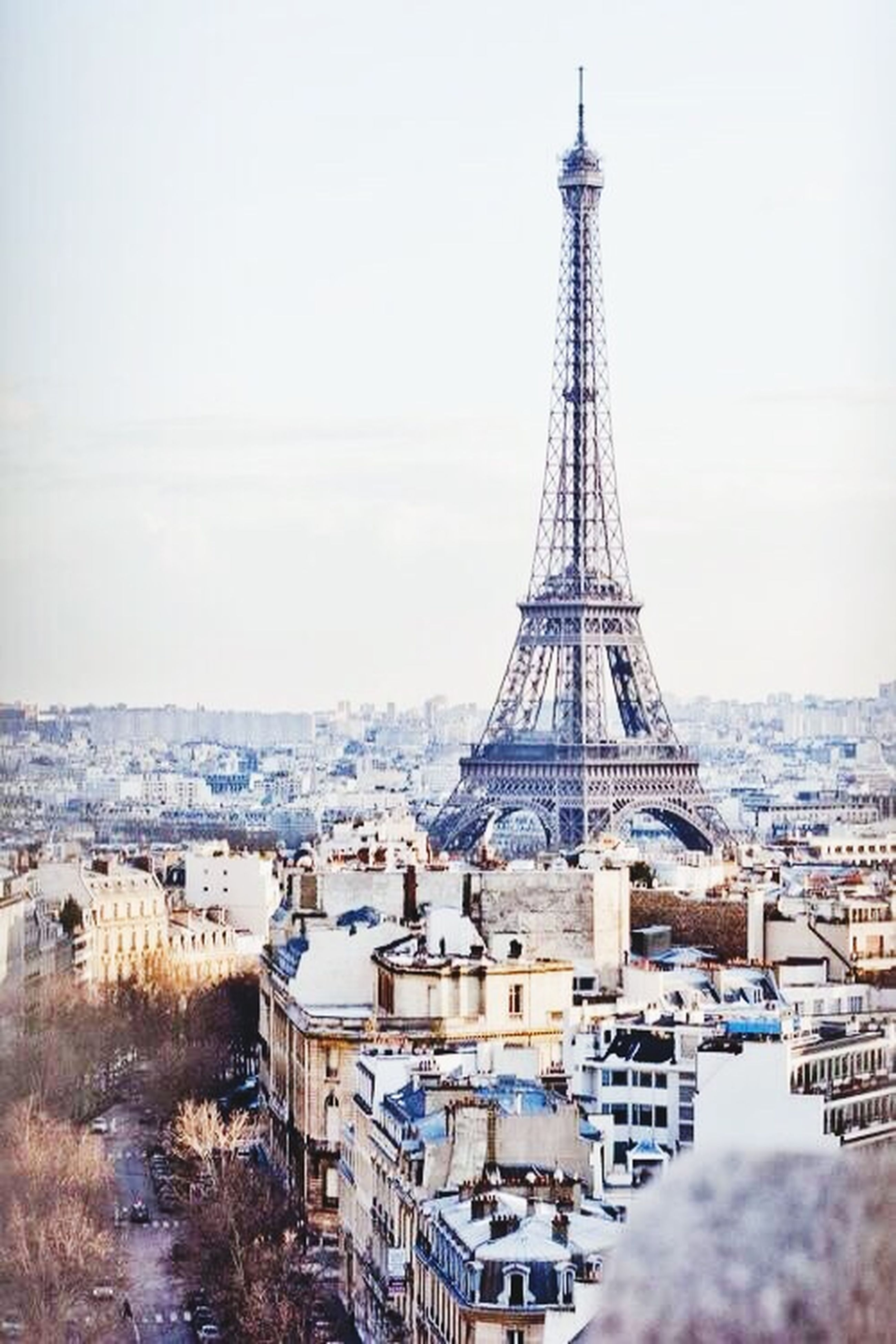 architecture, built structure, famous place, travel destinations, tourism, international landmark, building exterior, clear sky, travel, eiffel tower, water, capital cities, incidental people, culture, tower, sky, city, day, sea, outdoors