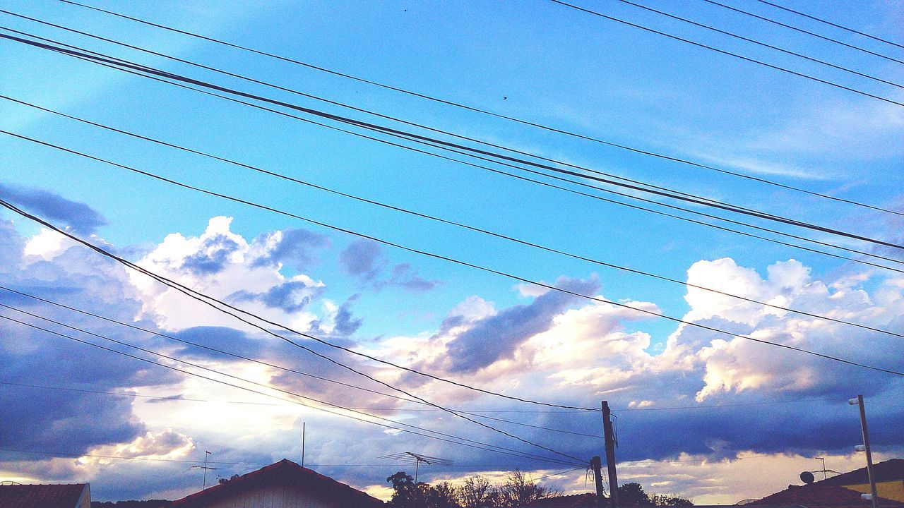 Low Angle View Of Silhouette Electricity Cables Against Sunset Sky