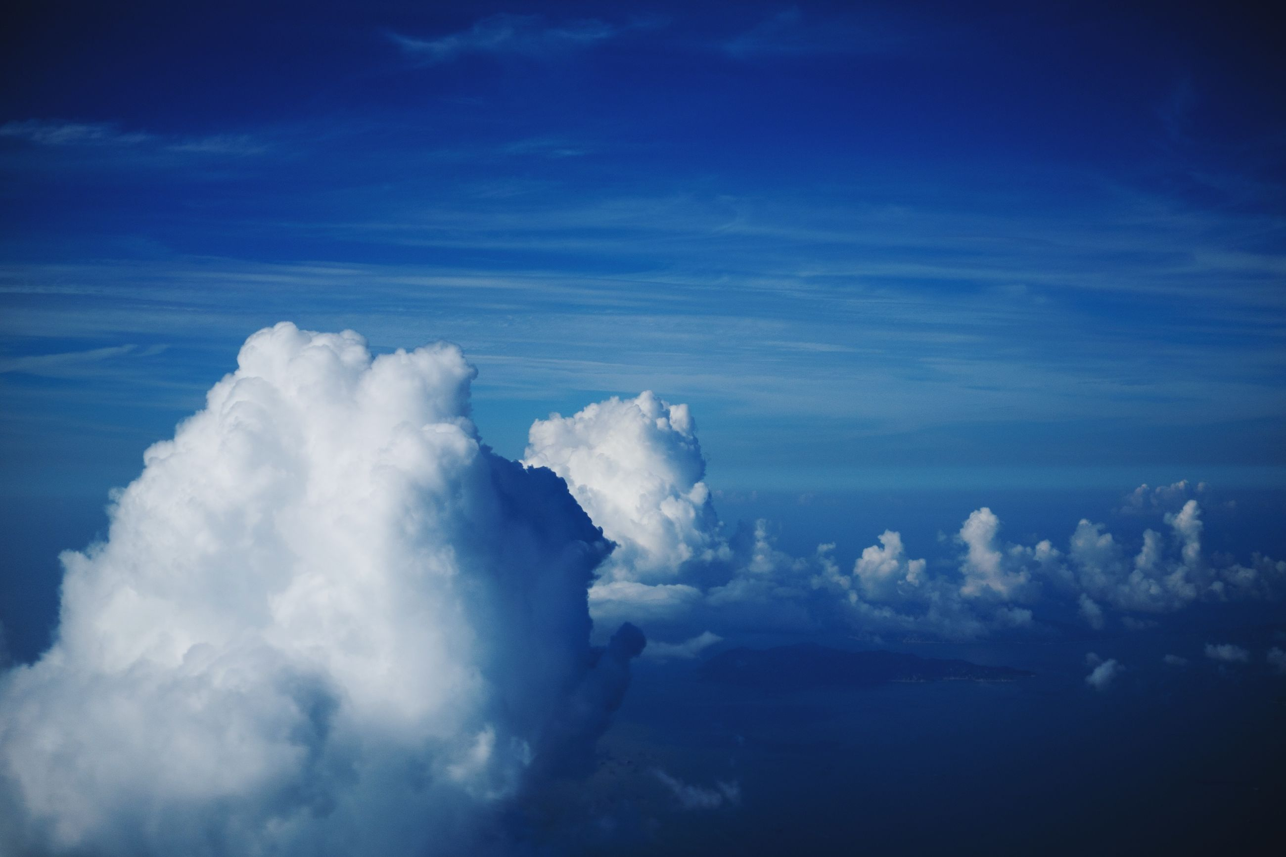 beauty in nature, scenics, sky, blue, tranquility, tranquil scene, nature, cloud - sky, cloudscape, white color, sky only, cloud, idyllic, majestic, fluffy, cloudy, no people, day, low angle view, outdoors