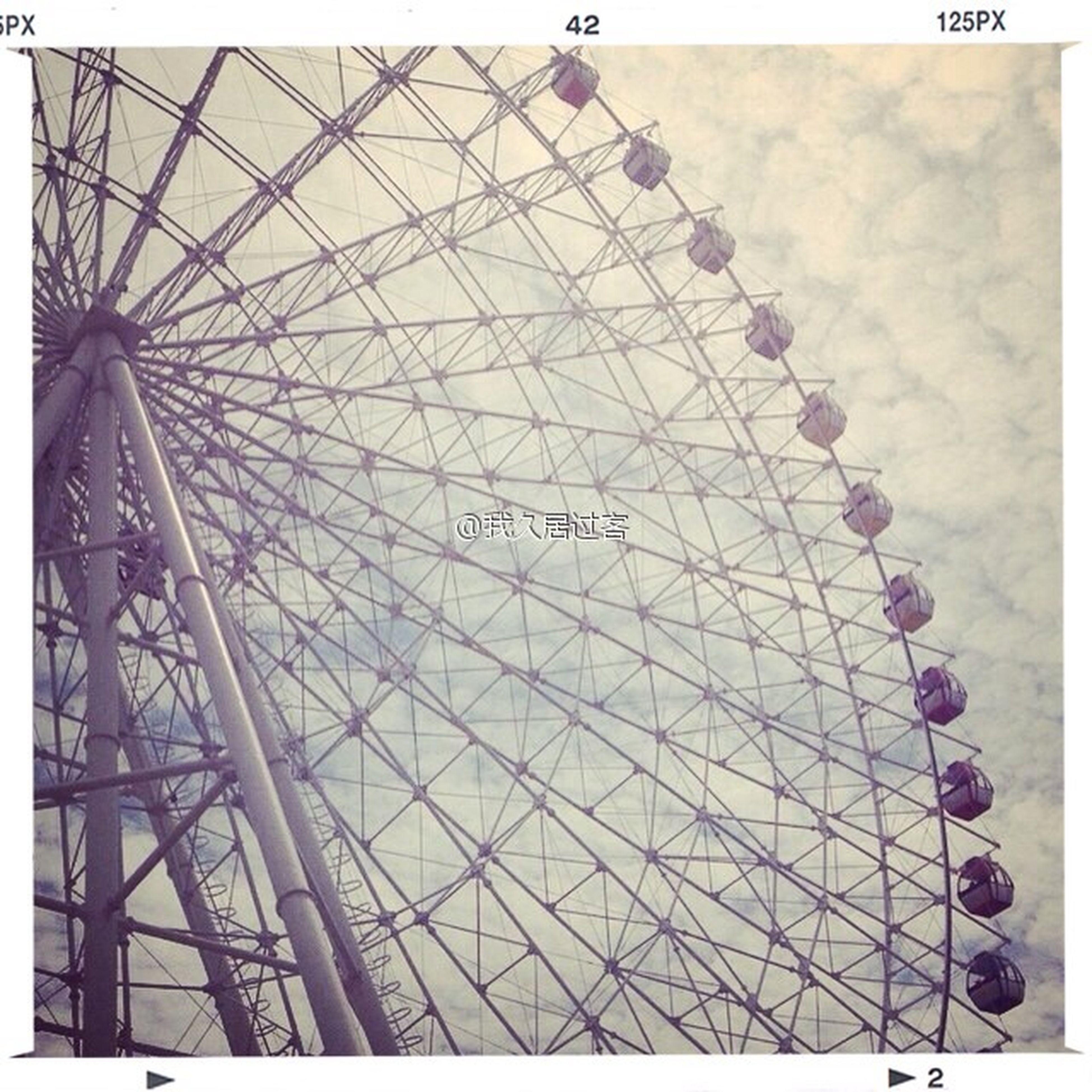 low angle view, transfer print, built structure, amusement park, ferris wheel, amusement park ride, architecture, metal, pattern, auto post production filter, design, arts culture and entertainment, day, sky, metallic, famous place, geometric shape, indoors, capital cities