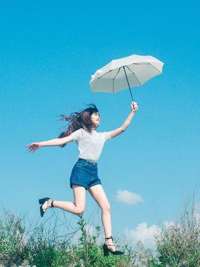 Girl Jump Umbrella Blue Sky