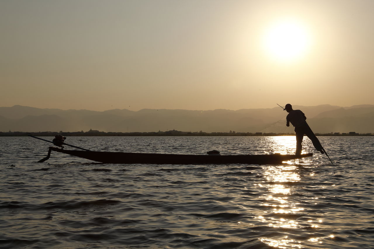 Adult Beauty In Nature Boat Boating Fisherman Fishing Fishing Boat Lake Lake View Mountain Nature One Person Outdoors People Scenics Silhouette Sky Sunrise_sunsets_aroundworld Sunset Sunset Silhouettes Sunset_collection Traditional Culture Water Working Working Hard