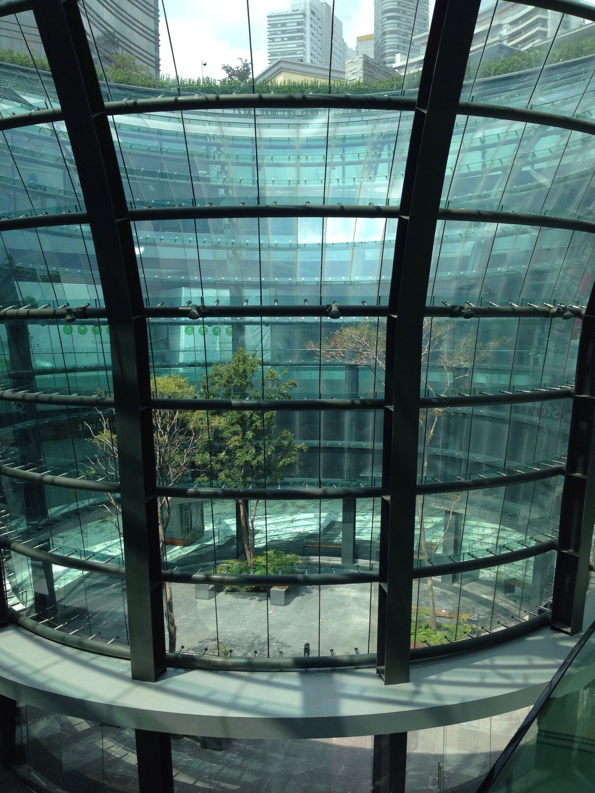 architecture, built structure, indoors, glass - material, window, building exterior, transparent, modern, ceiling, reflection, building, glass, city, pattern, day, no people, sunlight, interior, architectural feature, office building