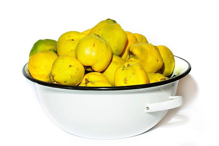 Yellow quinces in white bowl Yellow Quince White Bowl Apple Lot Fruit Harvest Ripe