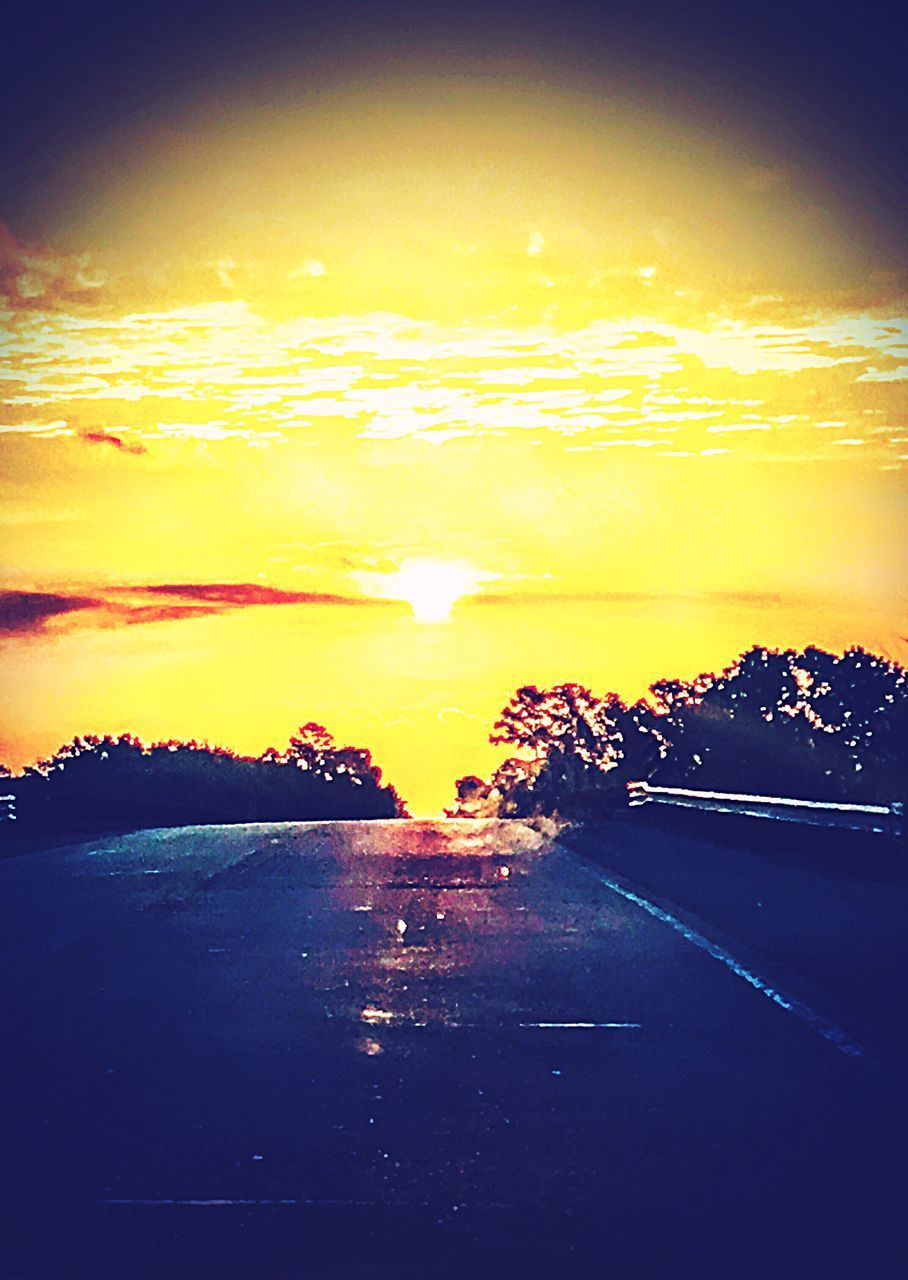 sunset, sky, scenics, beauty in nature, nature, no people, dramatic sky, sun, tranquility, tranquil scene, road, transportation, silhouette, outdoors, water, tree, day