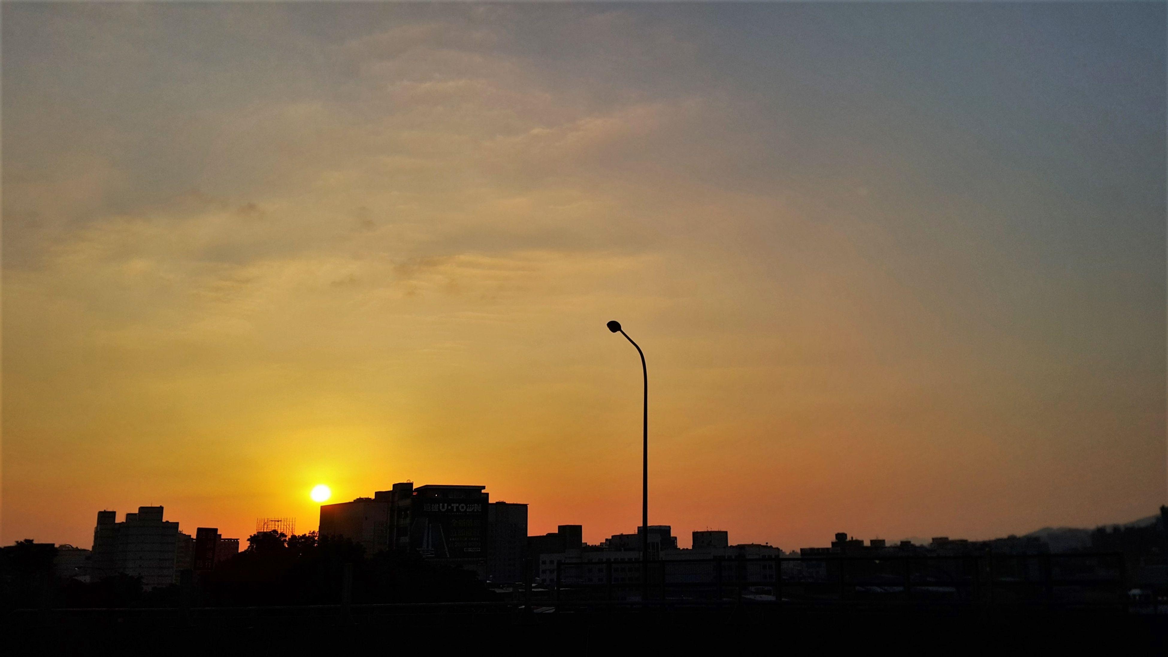 sunset, building exterior, silhouette, architecture, built structure, orange color, city, sun, sky, cityscape, skyscraper, building, cloud - sky, sunlight, urban skyline, tower, outdoors, residential building, scenics, beauty in nature