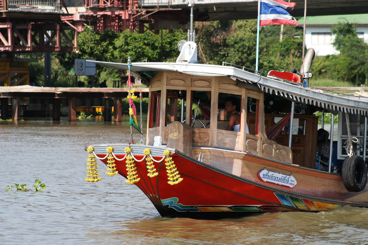 Bangkok City City Life Day Flag Incidental People Mode Of Transport Multi Colored Outdoors Reflection Spotted In Thailand Thailand Transportation Water Ferry Rides Window