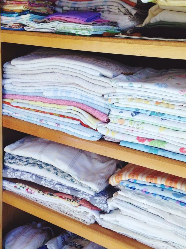 Everything In Its Place closeup shoot of folded linen ,stacked high full of color and great assortment . Organized Neatly👍😝