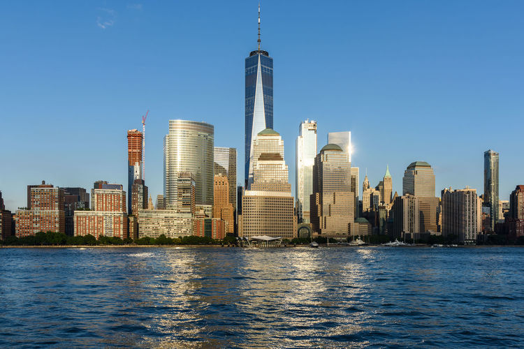 Manhattan New York City USA Architecture Blue Building Exterior Built Structure City Cityscape Downtown District Financial District  Growth Modern No People Outdoors River Sky Skyline Skyscraper Tall - High Tower Travel Destinations Urban Skyline Water Waterfront