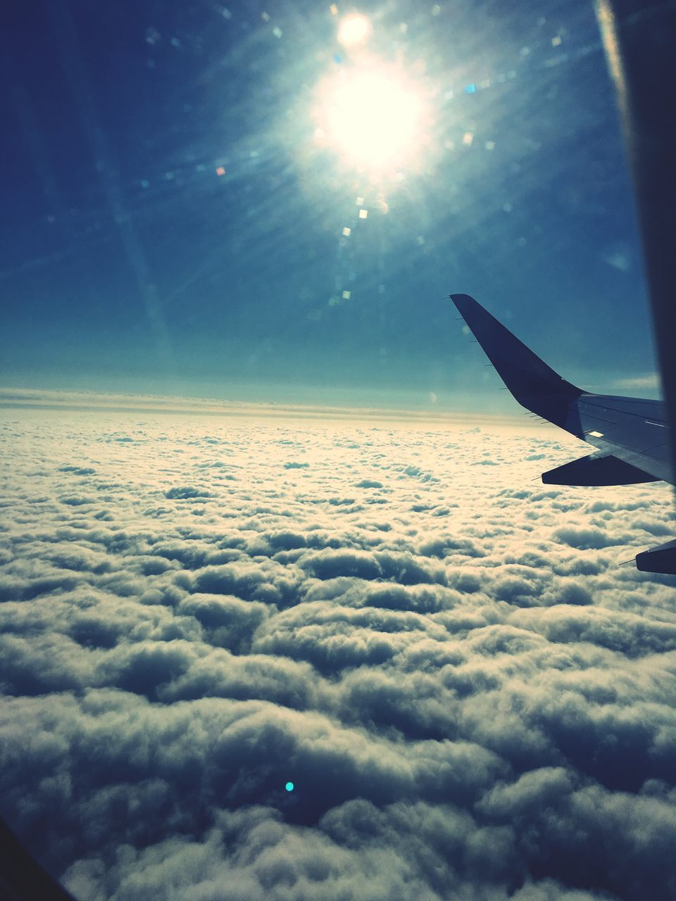 sky, airplane, nature, sun, cloudscape, beauty in nature, transportation, cloud - sky, airplane wing, flying, tranquility, tranquil scene, scenics, aerial view, no people, journey, blue, mid-air, air vehicle, aircraft wing, outdoors, the natural world, close-up