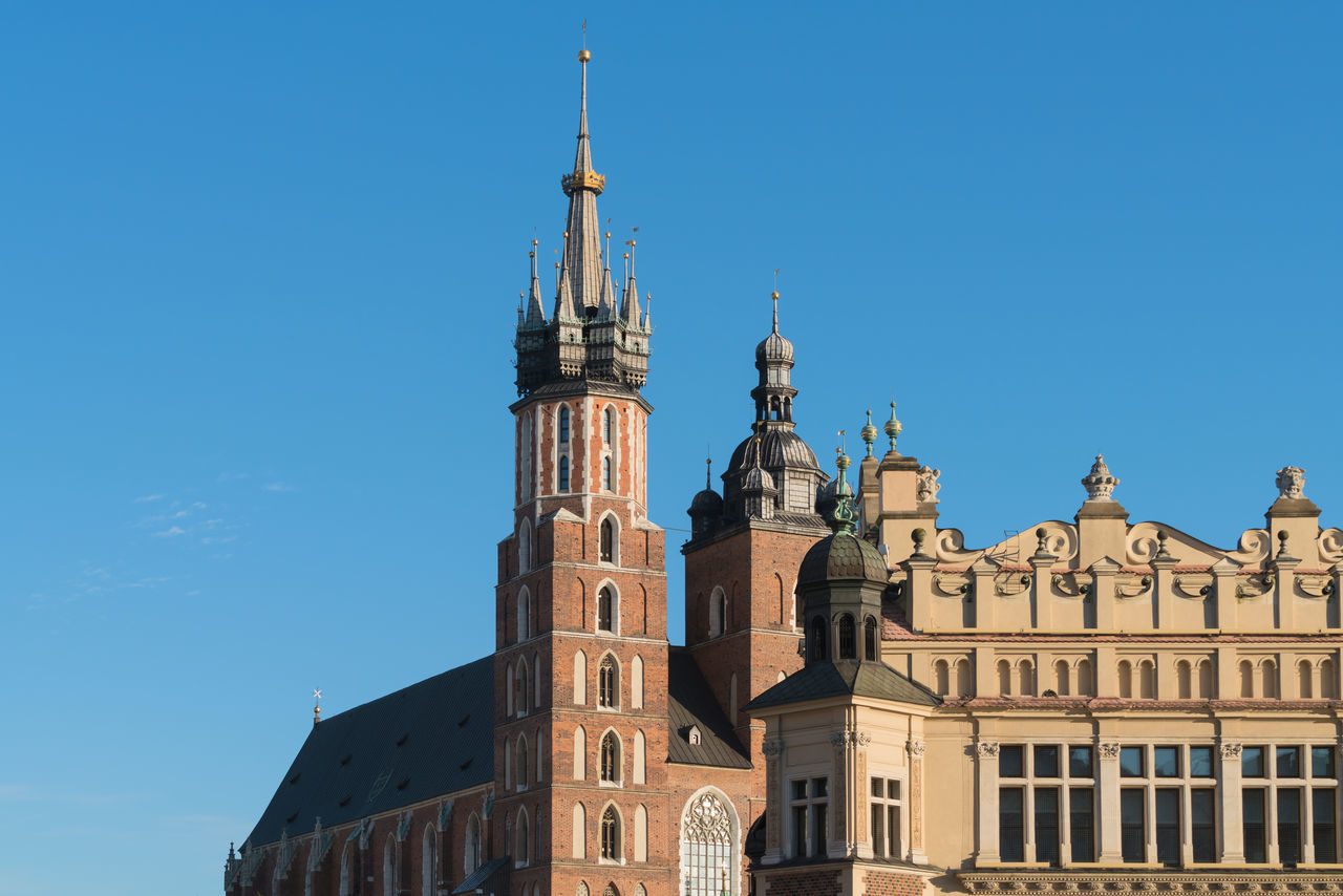 Cracow (Krakow), Poland - Landmarks of the Old Town: St. Mary's Basilica and the Cloth Hall Architecture Building Exterior Built Structure Church City Clear Sky Cracow Day Europe History Krakow Krakow,Poland Low Angle View No People Outdoors Place Of Worship Poland Polish Sky St Mary's Sukiennice Sunlight