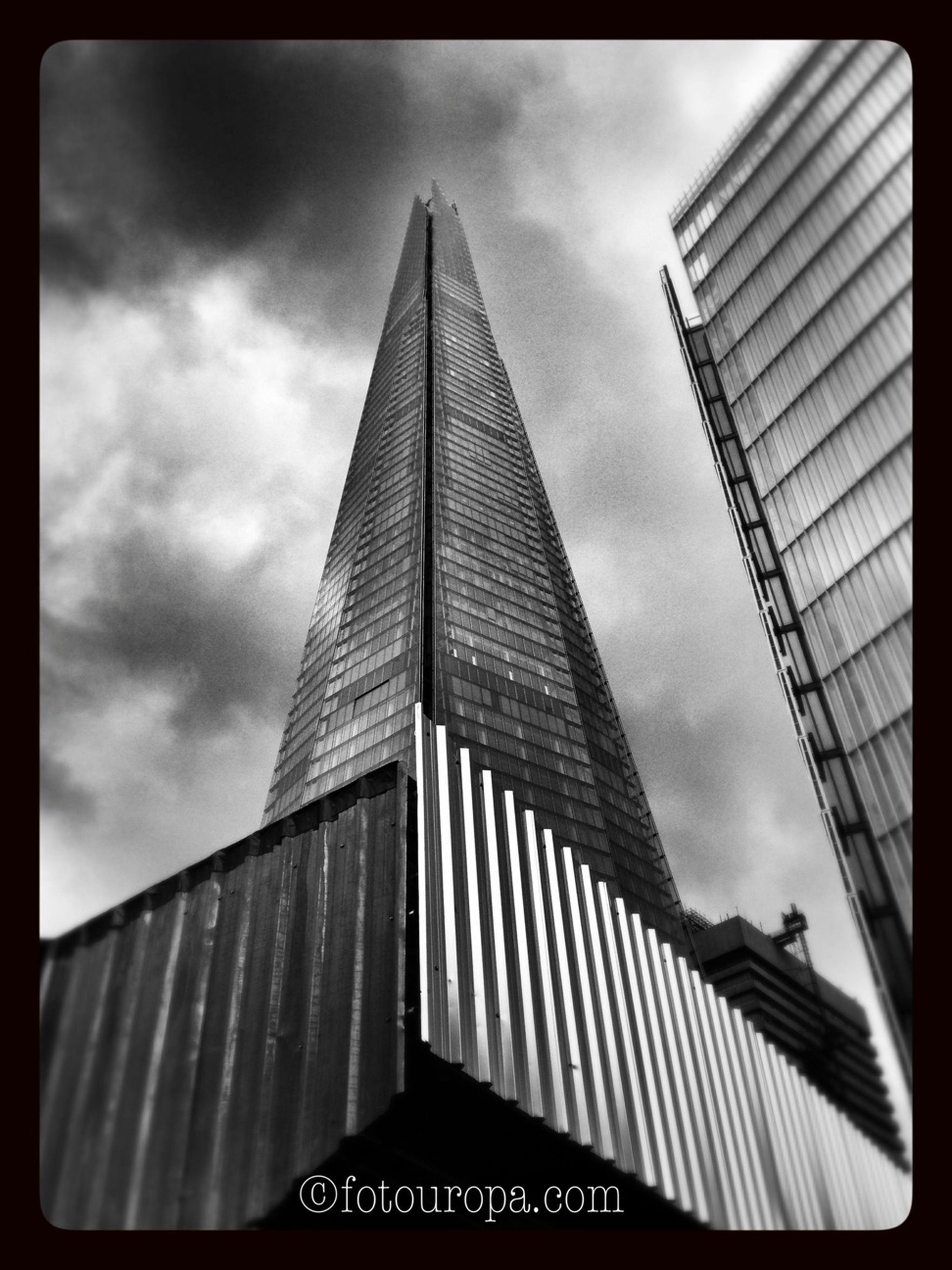 architecture, building exterior, low angle view, built structure, sky, modern, city, skyscraper, tall - high, tower, office building, transfer print, building, cloud - sky, auto post production filter, tall, cloudy, cloud, day, outdoors