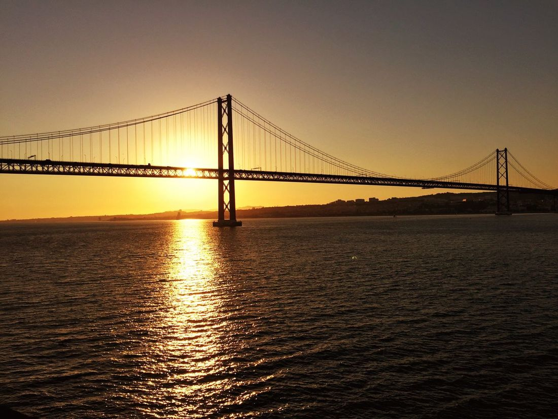 Sunset in Lisbon, Portugal 🌞 Bridge - Man Made Structure 25aprilbridge Water Ocean Ocean View Sunset Travel Destinations Sky Sunlight Outdoors No People Tourism Transportation Tranquility Nature Bridge Day in Lisbon