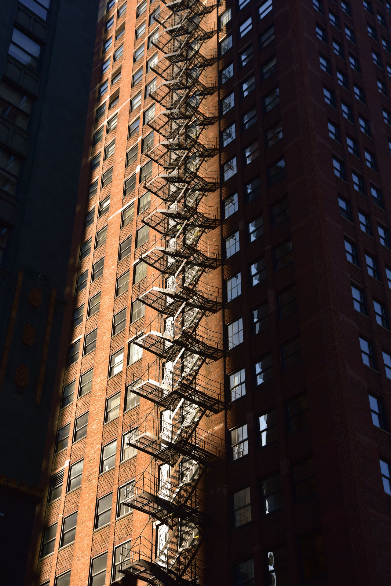 Architecture Big City brick building exterior City early morning Feuertreppe Fire Escape Low angle view skyscraper sunshine The City Light